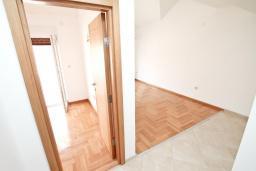 Гостиная. Продается квартира в Герцег-Нови, Дженовичи. 48м2, гостиная, спальня, большой балкон с видом на море, 70 метров до пляжа, цена - 105'600 Евро.  в Дженовичи