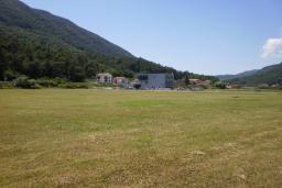 Земельный участок в Герцег-Нови – Суторина, площадью 2344м2. Предназначение для постройки спортивных сооружений. Около магистрали, рядом с автосалоном Citroen. в Игало