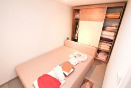 Спальня. Продается квартира в Нивице. 35м2, гостиная, спальня, терраса, 100 метров до моря, цена - 46'350 Евро. в Нивице